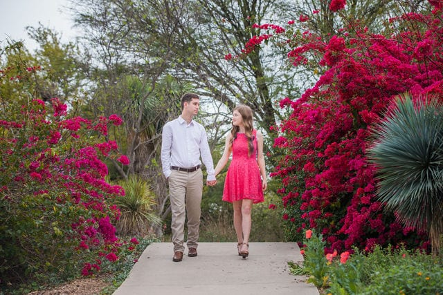 Claire & Josh engagement session San Antonio Botanical Gardens on top of the hill walking