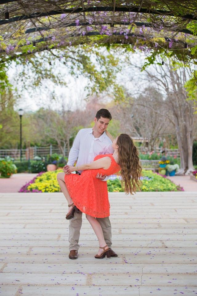 Claire & Josh engagement session San Antonio Botanical Gardens wisteria dip
