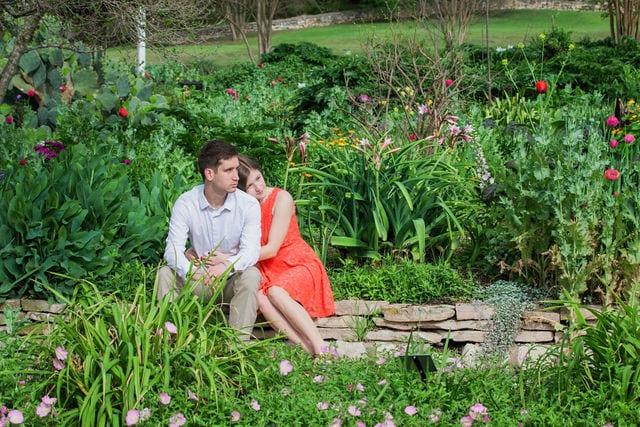 Claire & Josh engagement session San Antonio Botanical Gardens sitting in the spring garden