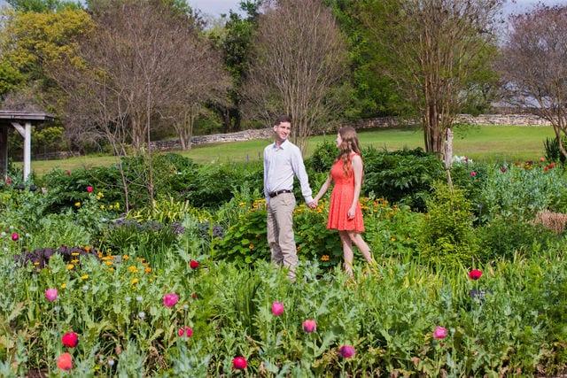 Claire & Josh engagement session San Antonio Botanical Gardens walking in the spring garden