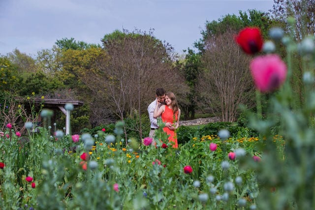Claire & Josh engagement session San Antonio Botanical Gardens hugging in the spring garden