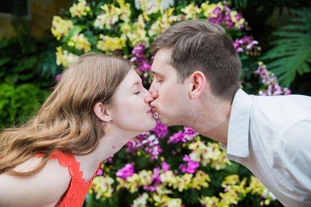 Claire & Josh engagement session San Antonio Botanical Gardens orchid wall kiss