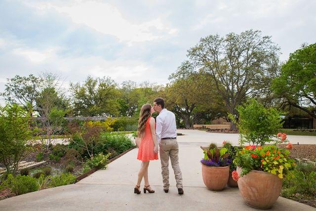 Claire & Josh engagement session San Antonio Botanical Gardens walking out of arboretum