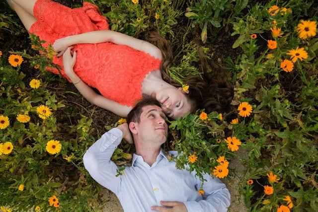 Claire & Josh engagement session San Antonio Botanical Gardens laying down