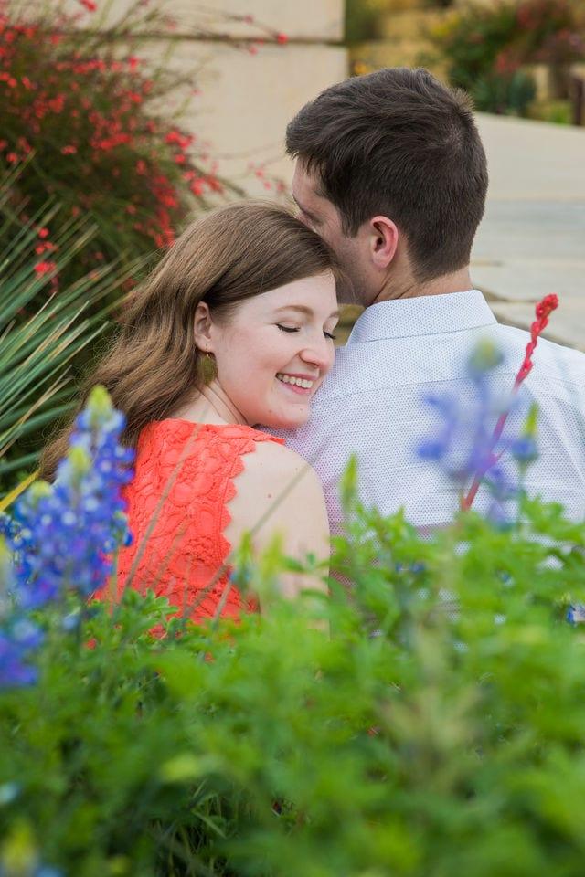 Claire & Josh engagement session San Antonio Botanical Gardens bluebonnett hug