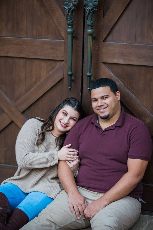 Dana and Andrews engagement session at the Pearl Stable doors laughing