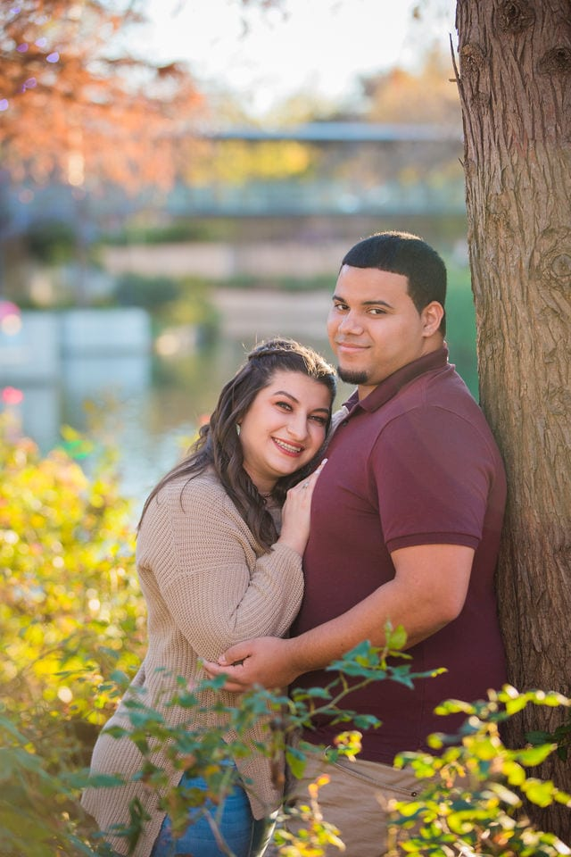 Dana and Andrews engagement session at the Pearl by the tree and river