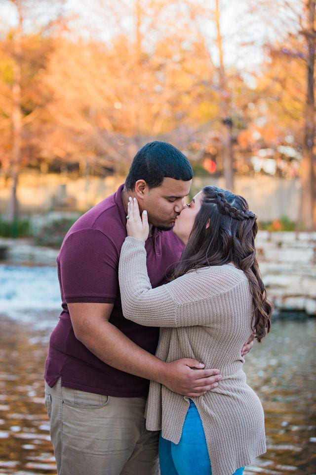 Dana and Andrews engagement session at the Pearl riverwalk kiss