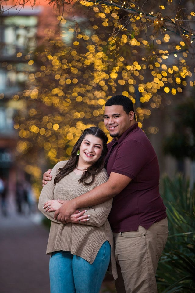 Dana and Andrews engagement session at the Pearl with Christmas lights