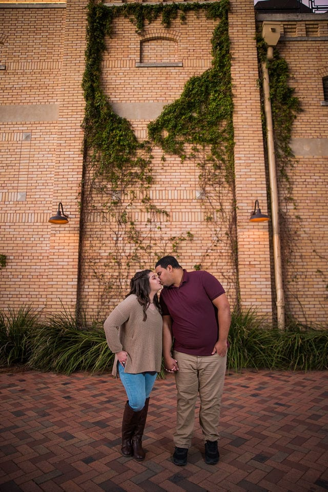 Dana and Andrews engagement session at the Pearl sunset wall